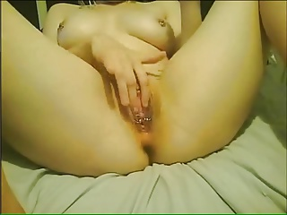 Webcam slut fists her pierced pussy