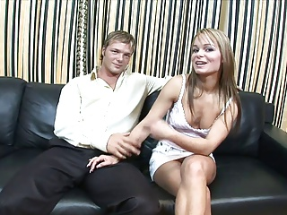 Blonde with small tits deep throats cock on the sofa