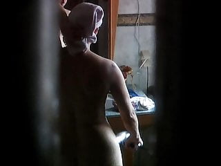 Milf Sandra drying pussy and ass after shower