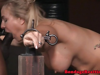 Bonded babe spitroasted by male dominators