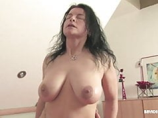 Old German slut makes her melons bounce on mature dick