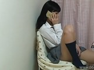 Japanese slender girl of the masturbating while telephone.